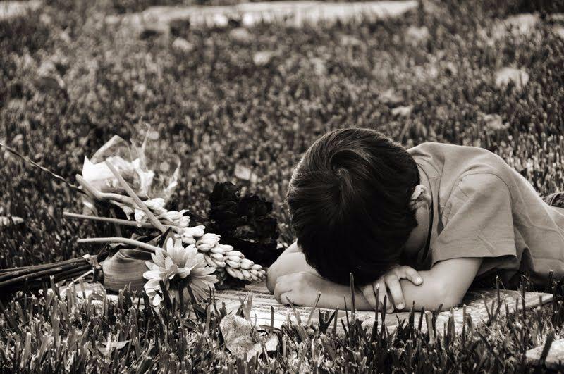 niño tumba